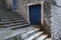 Blue doors. On stone stairway royalty free stock image