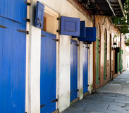 Blue Doors on Street. Historic New Orleans  building with blue and green doors Stock Photos