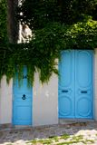 Blue doors on the street Royalty Free Stock Photo