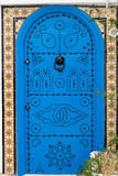 Blue doors and white wall of building in Sidi Bou Said Stock Photo