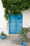Blue doors and white wall of building in Sidi Bou Said Stock Image