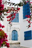 Blue doors, window and white wall of building in Sidi Bou Said Stock Image