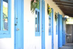 Blue doors and windows Stock Images