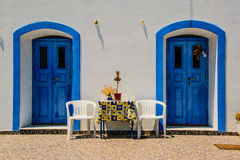 Blue doors at wite wall Royalty Free Stock Photography