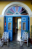 Blue doorway and rocking chairs in Spanish Villa Royalty Free Stock Images