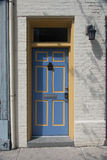 Blue doorway in white wall Royalty Free Stock Images
