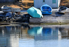 Blue Dories. Three dory boats pulled up on shore in Peggys Cove, Nova Scotia Royalty Free Stock Image