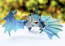 Blue dragon flying with green bokeh   background royalty free stock image