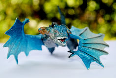 Blue dragon flying. (toys)   with green bokeh background Royalty Free Stock Images