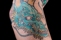 Blue Dragon Tattoo on Arm Stock Images