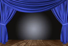 Blue Draped Stage With Wood Floor Royalty Free Stock Photos