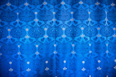 Blue drapery textile with the royal crown Stock Images