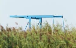 Blue drawbridge hidden in the reeds Stock Photo
