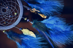 Blue dream catcher hanging on dark background Royalty Free Stock Image