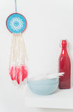 Blue dream catcher with red feathers Royalty Free Stock Image