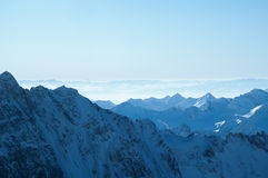 Blue dream of mountains. Winter mountains of ala-archa, Kyrgyzstan. View of the snowed up valleys over the ridge on foreground Royalty Free Stock Photos