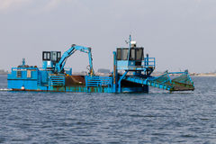 Blue dredger Royalty Free Stock Image