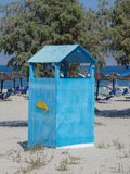 Blue dress cabin at the beach with a swimming suit hanging out Stock Photo