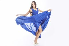 Blue dress fluttering on wind, copy space Stock Image