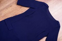 Blue dress with sleeve two thirds. Dark autumn dress on floor royalty free stock images