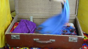 Blue dress suitcase Stock Photo
