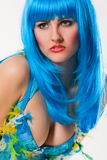 Blue dress and wig. Attractive woman with blue wig Royalty Free Stock Photography