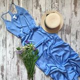 Blue dress on a wooden background royalty free stock photography