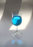 Blue drink. A classic glass with blue drink inside, backlit Stock Images