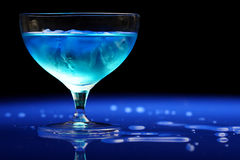 Blue drink. Splashed on blue table Stock Photography