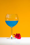 Blue drink and bougainvillea Royalty Free Stock Images