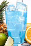 Blue drink with fruits Royalty Free Stock Image