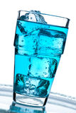 Blue drink with ice cubes Royalty Free Stock Images
