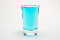 Blue drink in shot glass. On white Stock Photo
