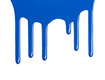 Blue dripping paint against a white background Royalty Free Stock Images