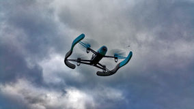 Blue drone on the storm sky Stock Photo