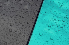 Blue drop on car Royalty Free Stock Image