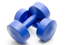 Blue dumbbells. Blue dumbbell for the fitness Royalty Free Stock Photography