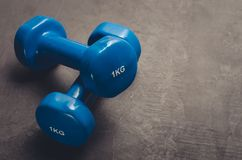 Blue dumbbells against a dark background/sports concept blue dumbbells against a dark background. Top view and copy space stock photos