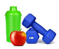 Blue dumbbells with apple and protein shaker Stock Image
