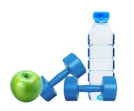 Blue dumbbells fitness, green apple and bottle of water Royalty Free Stock Image