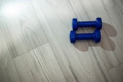 Blue dumbbells on the floor royalty free stock photos