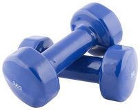 Blue dumbbells isolated. Blue dumbbells on isolated background Royalty Free Stock Photography