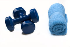 Blue Dumbbells With Blue Towel Stock Photography