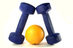 Blue Dumbbels and orange. Blue Dumbbels and tasty orange over white Stock Image