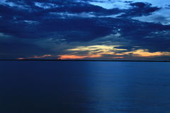 Blue Dusk. Blue Clouds and Blue Water on Lake Erie at dusk Stock Image