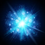 Blue dust explosion on black background Royalty Free Stock Photography