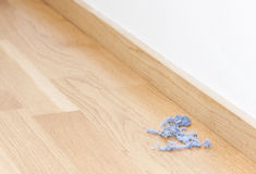 Blue dust rolls on the floor Stock Images