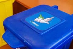 Blue dustbin for paper waste. Stock Images