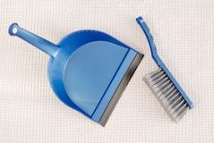 Blue dustpan Royalty Free Stock Photo