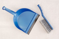 Blue dustpan and broom Stock Photo